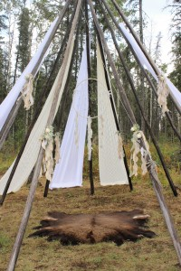 The teepee which had been draped in panels of vintage lace, soft white voile and accented with floral posies and taffeta ribbons.