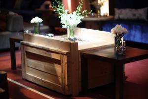 A used crate, recycled as a unique event cocktail table | Events with Vizability