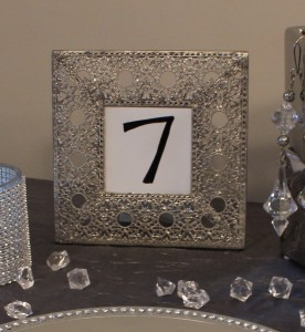 Adding texture like this filigree table number elevates the design and balances stronger table accents.  | Events with Vizability