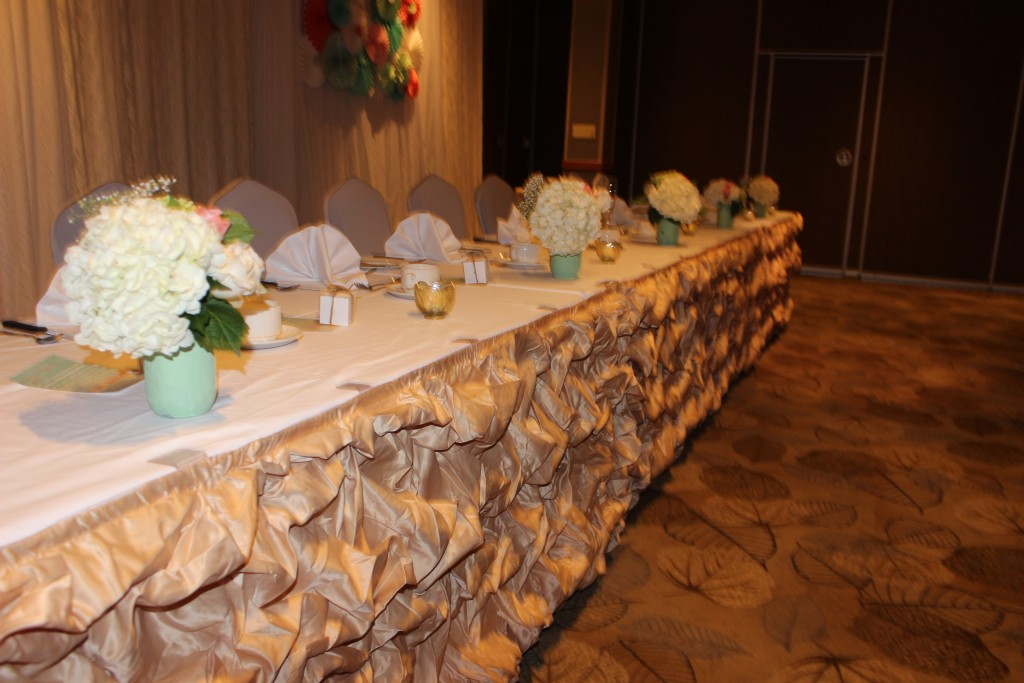 The head table was skirted in billowy champagne and topped with custom mint hand painted mason jars for a vintage feel.