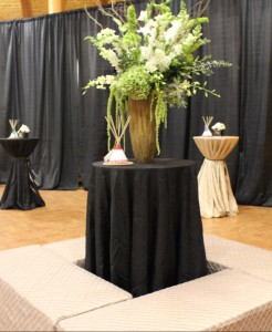 To create a sense of place we dress the landing with seating and a tall floral arrangement.