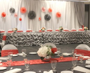 The head table was dressed with a backdrop of white voile with sweet patterned fans.