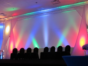 The stage had the event colours moving dramatically across the backdrop to create a sense of excitement and energy at the event.